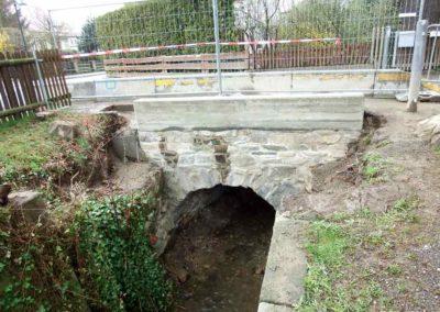 Teilweise Neuaufmauerung und Verfugung einer Bogenbrücke